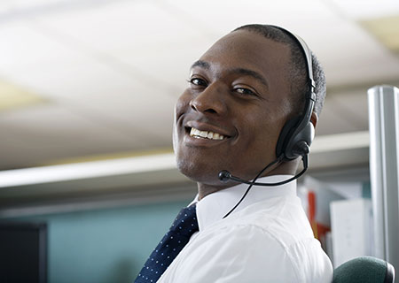 stock-photo-businessman-talking-on-headset-26979529
