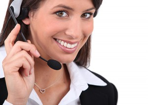 stock-photo-smiling-woman-with-headset-127994342